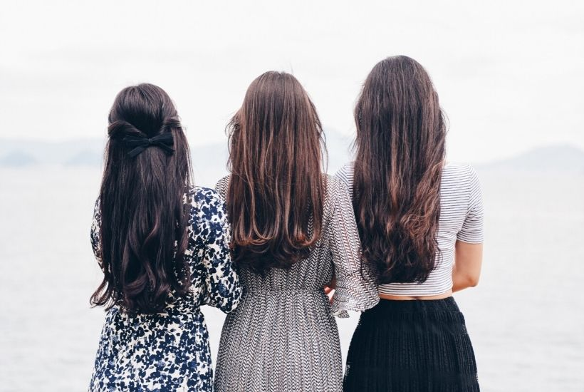 Three women facing away from the camera | Three Levels of Characters for Your Novel: Between the Lines Editorial